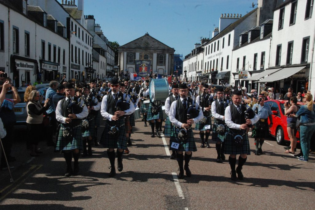 Inveraray and District Pipe Band lead the parade down Main Street.