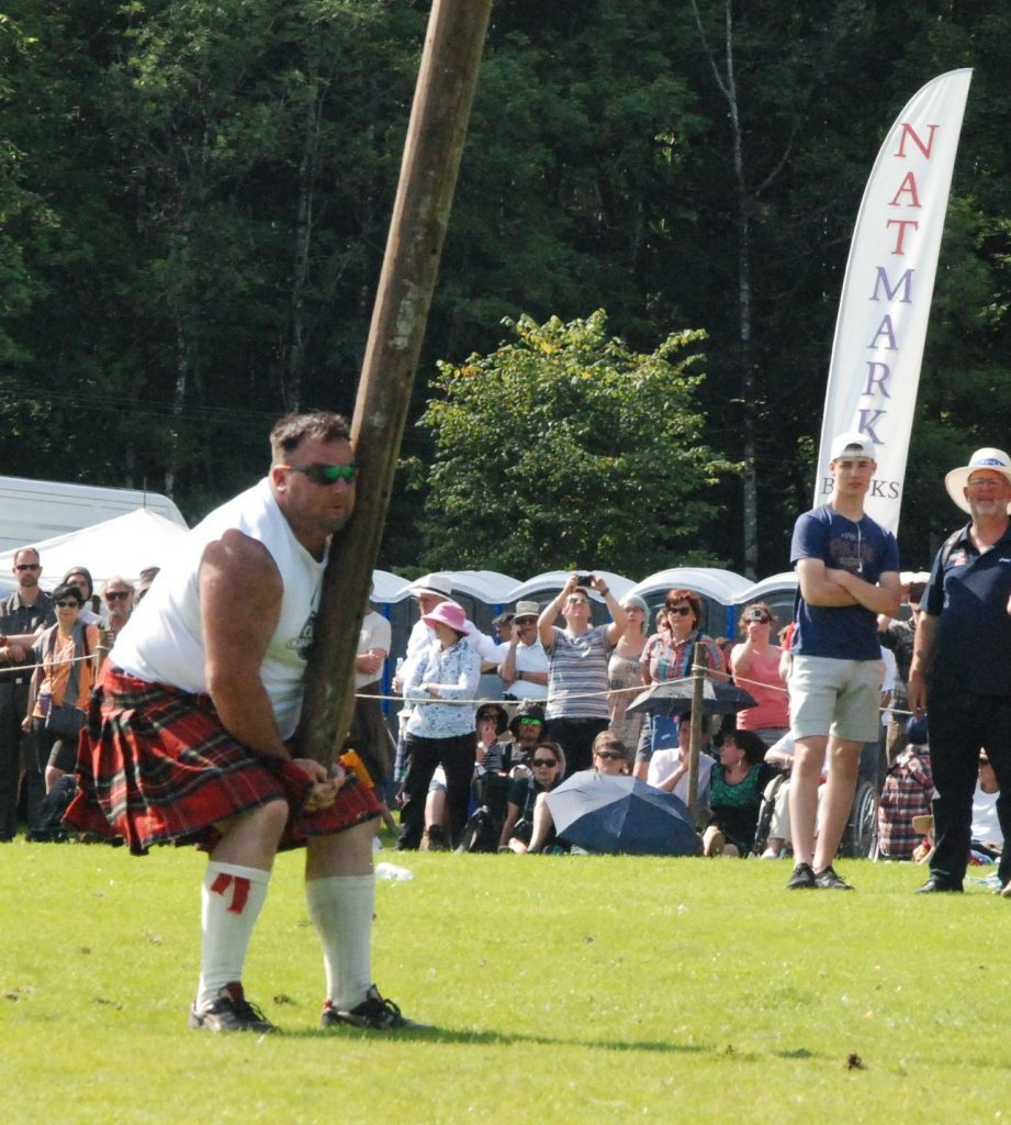 Pete Hart gets ready to toss the caber.