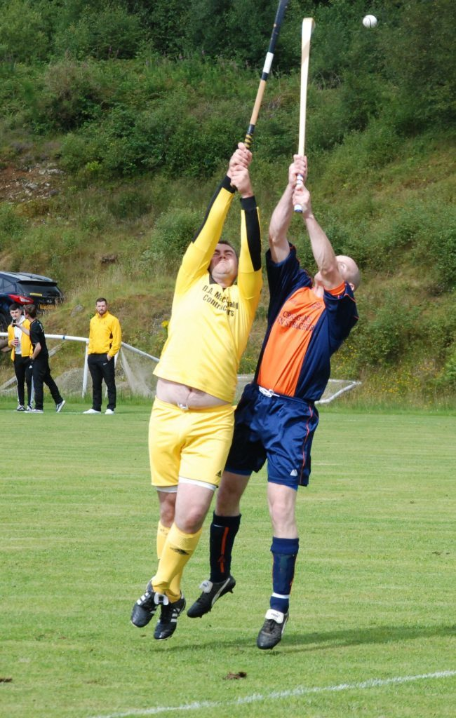 Inveraray's Neil Campbell and Ian MacLennan of Strachur tussle for a high ball. 06_a32shintybullough01
