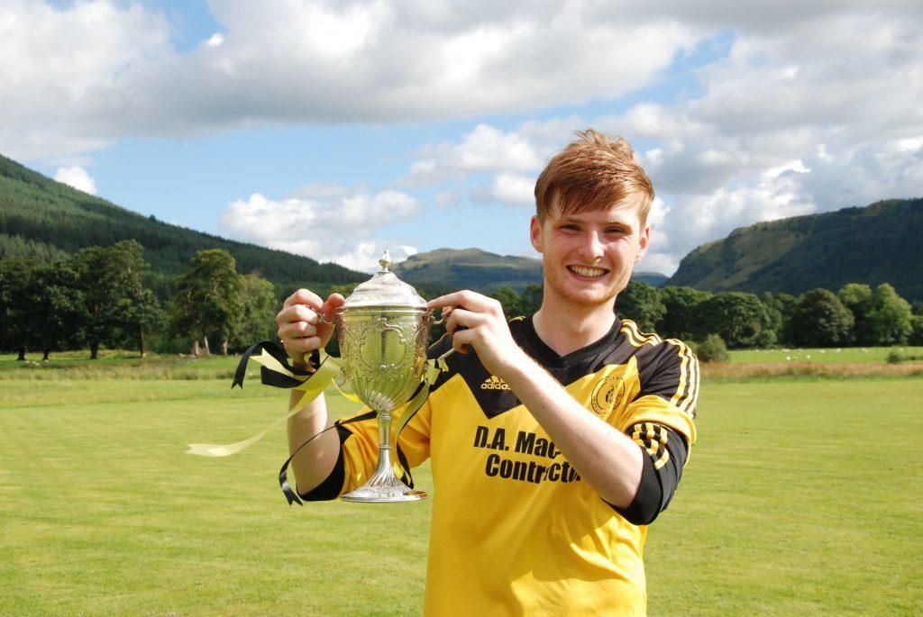 A delighted Inveraray captain, Allan Cameron, holds the Bullough Cup. 06_a32shintybullough08