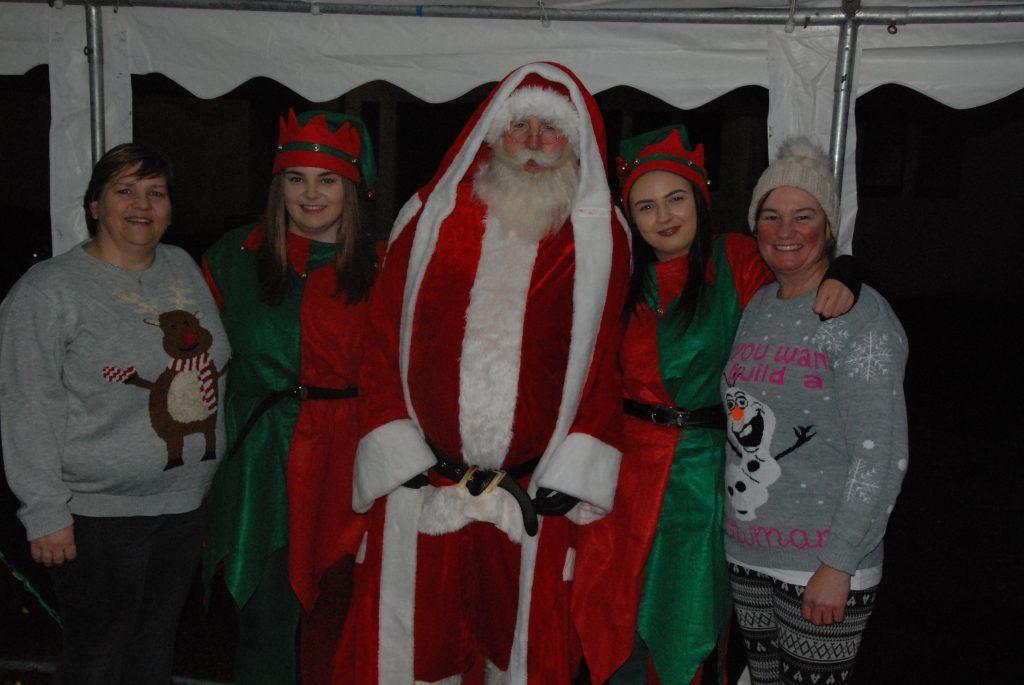 Santa and his elves alongside Lynn Gorrie and Donna Clarke. 08_a49ardrishaiglights05