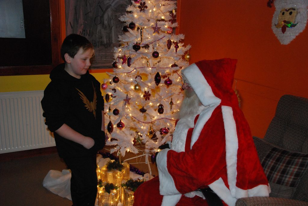 Santa asks young Sonny a few questions on what he would like for Christmas. 08_a49lochgilpheadlights01