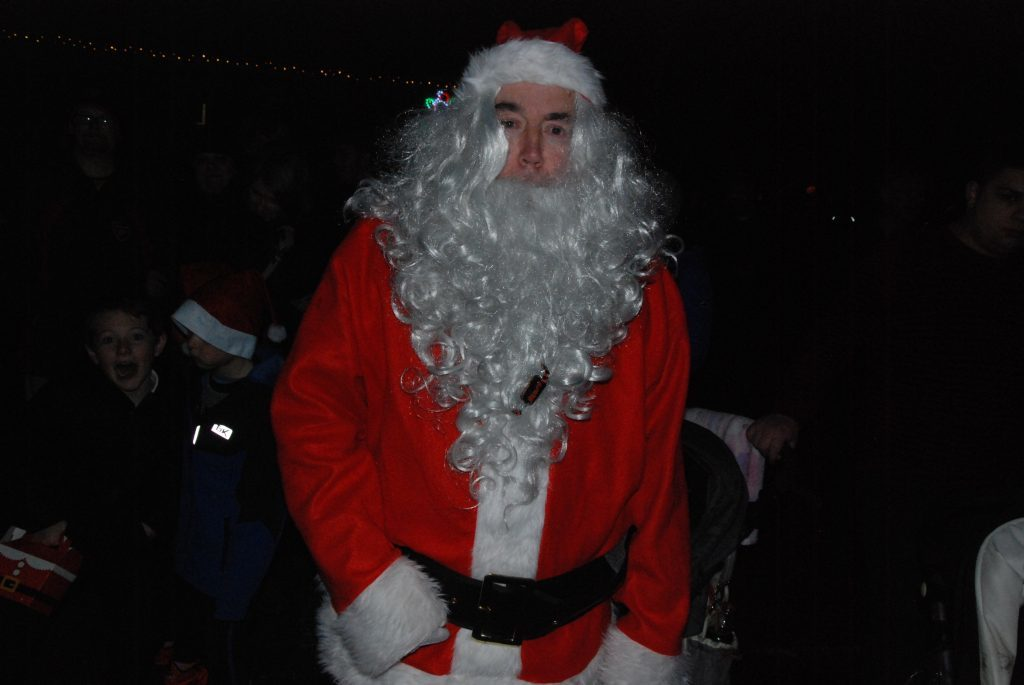 Pat McGinley who has dressed up as Santa for 17 years raising money at the light switch on. 08_a49lochgilpheadlights06
