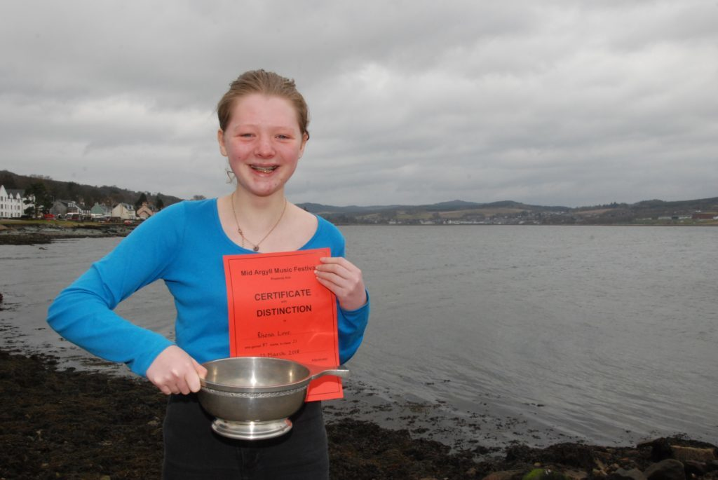 Rhona Love with the John Wilson Trophy after her win in the secondary school years one to three Scots folksong class.