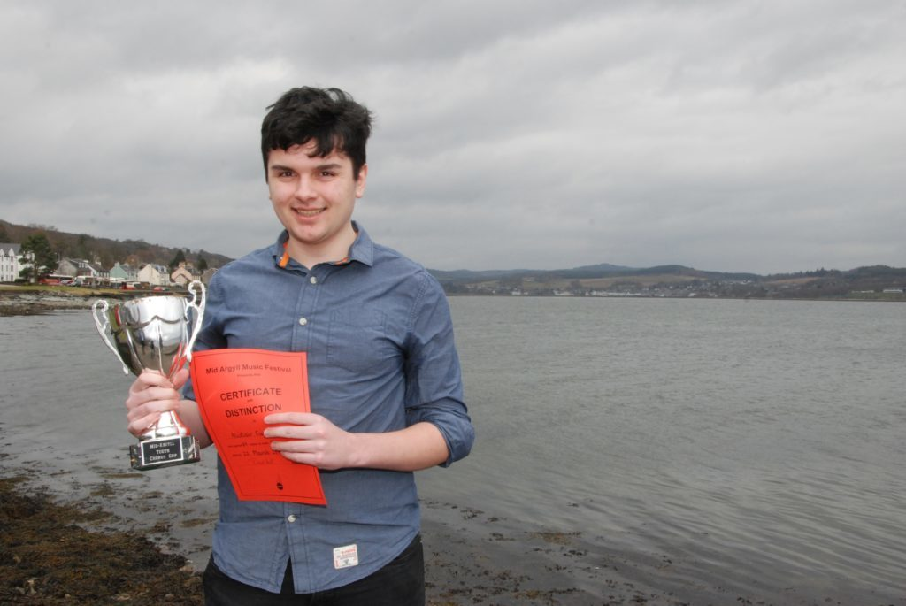 Alistair Cupples with the Mid Argyll Youth Chorus Cup after winning the Scots folksong class.