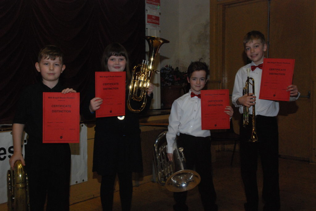 Beginner brass solo winners, left to right: James Barr, Eilidh Flanagan, John Bell and Arran Grant.