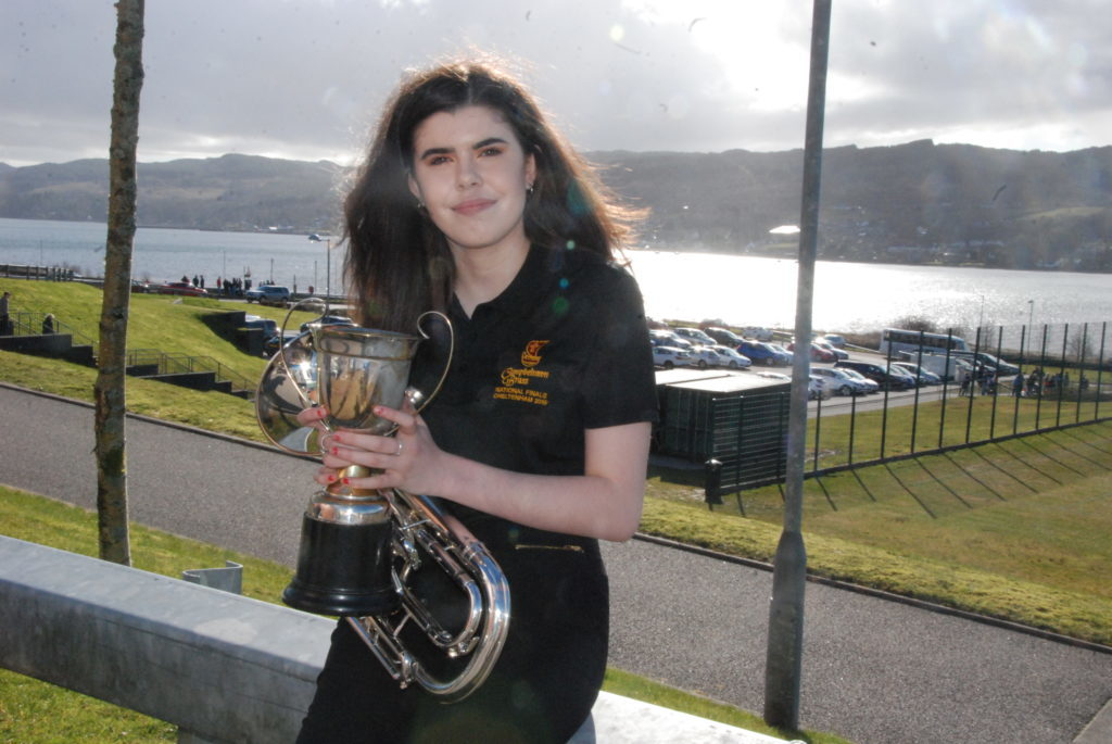 Amy Paterson with the Brackley Cup following her win in the brass solo.