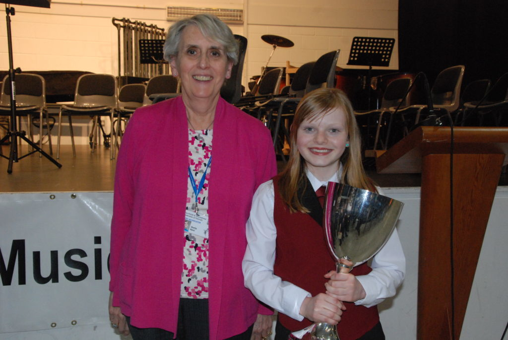 Adjudicator Sheila Kent with Hanna McCaig, aged 11, who brought the Co-Operative Premier Festival Award home to Campbeltown. The award is given to the most promising competitor, chosen by the adjudicators following the week's performances.