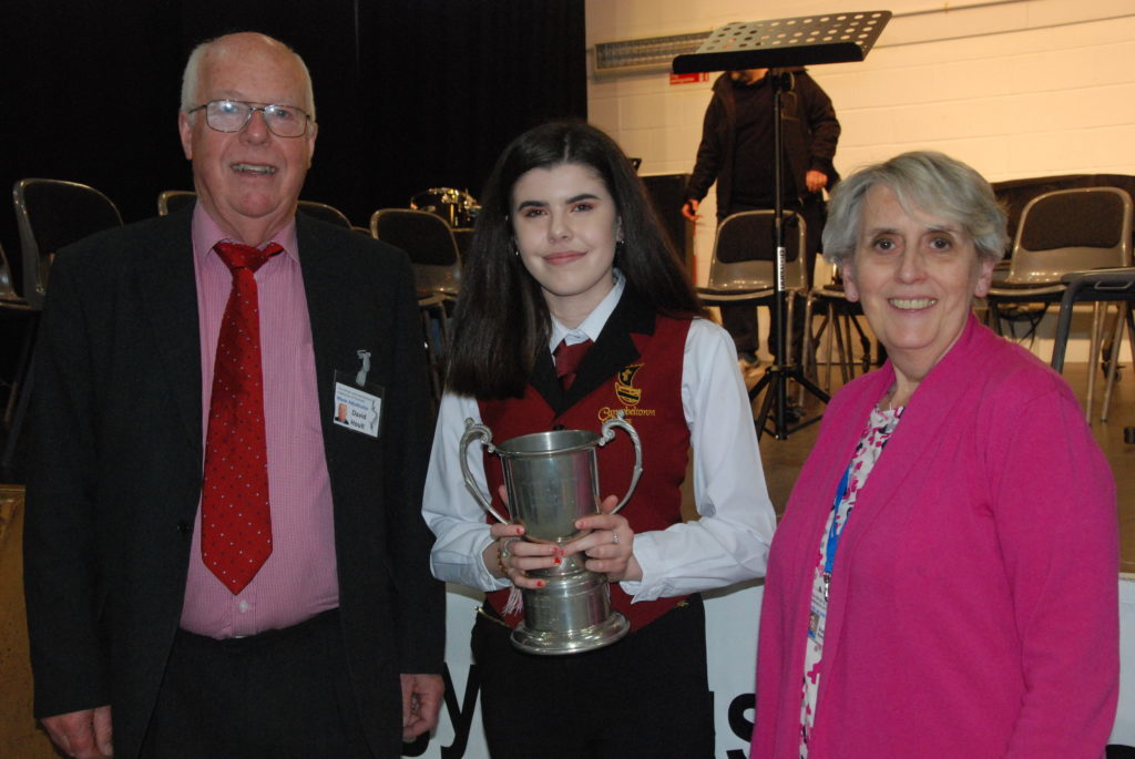 Amy Paterson, aged 16, won the Co-operative Membership Cup for the highest mark in solo brass. Amy also scored the highest mark of the festival with 91. She is pictured with adjudicators Professor David Hoult and Sheila Kent.