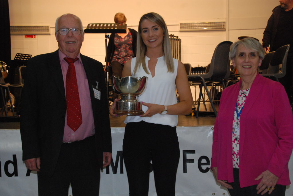 Campbeltown Brass, recently crowned Scottish Brass Band Champions, won the Gifford Bowl for the highest mark by a choir or band. Conductor Stephanie Mitchell is pictured with adjudicators David Hoult and Sheila Kent.
