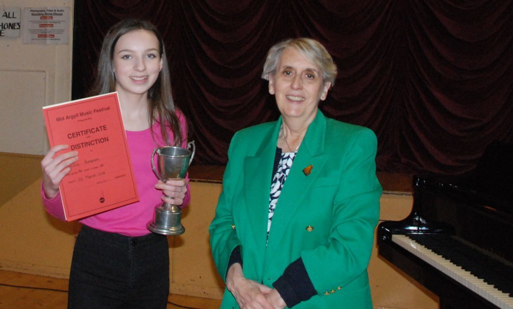 Grade four piano solo winner Ellie Simpson pictured with adjudicator Sheila Kent.