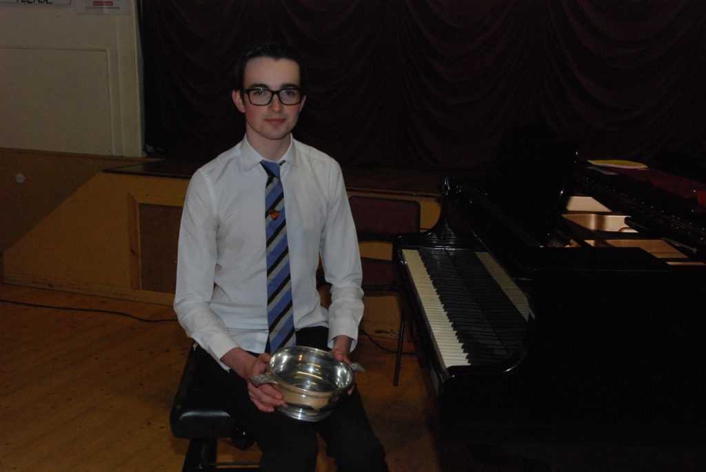 Piano solo sonata winner James Urquhart with the Portsonachan Plaers Quaich.