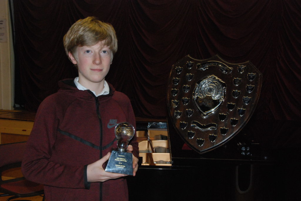 Winning the piano solo for 18 years and under was Ben Maddox, pictured here with the Smiddy Bistro Cup.