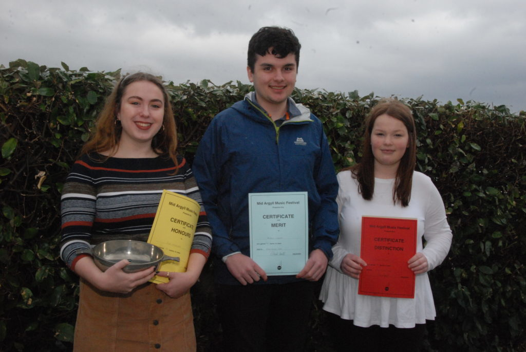 Eve Maxwell, Alistair Cupples and Holly Renton who placed in the vocal solo class with Eve winning the Argyllshire Advertiser Quaich.