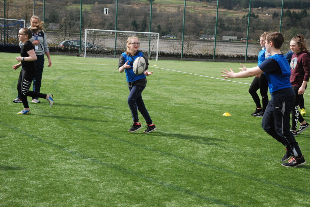 A Lochgilphead pupil aces a catch thanks to a pass from a classmate. 08_a17girlsrugby05