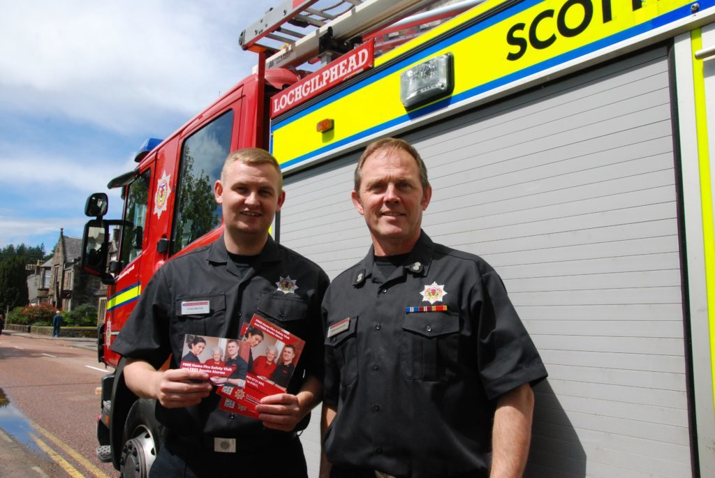 Lochgilphead firefighter Duncan MacBrayne and watch manager Duncan Litster proved a big attraction with their fire appliance. 06_a25AFD13
