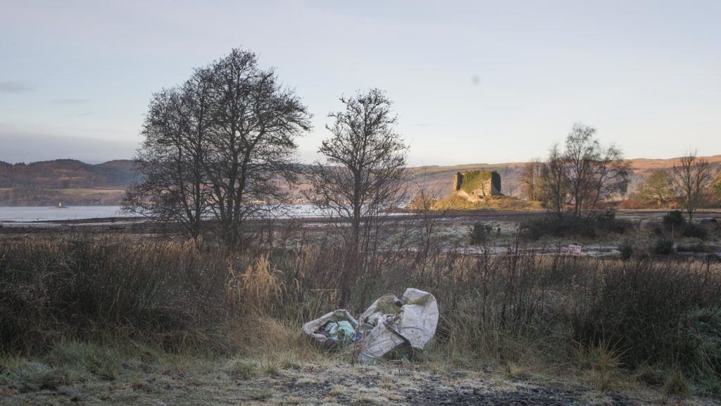 Plastic waste in the shadow of 15th century Castle Lachlan on the shores of Loch Fyne