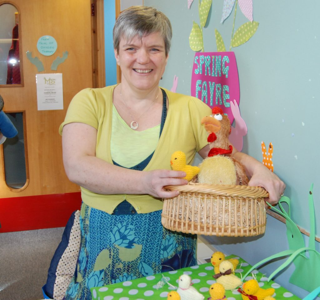Getting a wee bit clucky at the fayre was MS Centre manager Karen McCurry