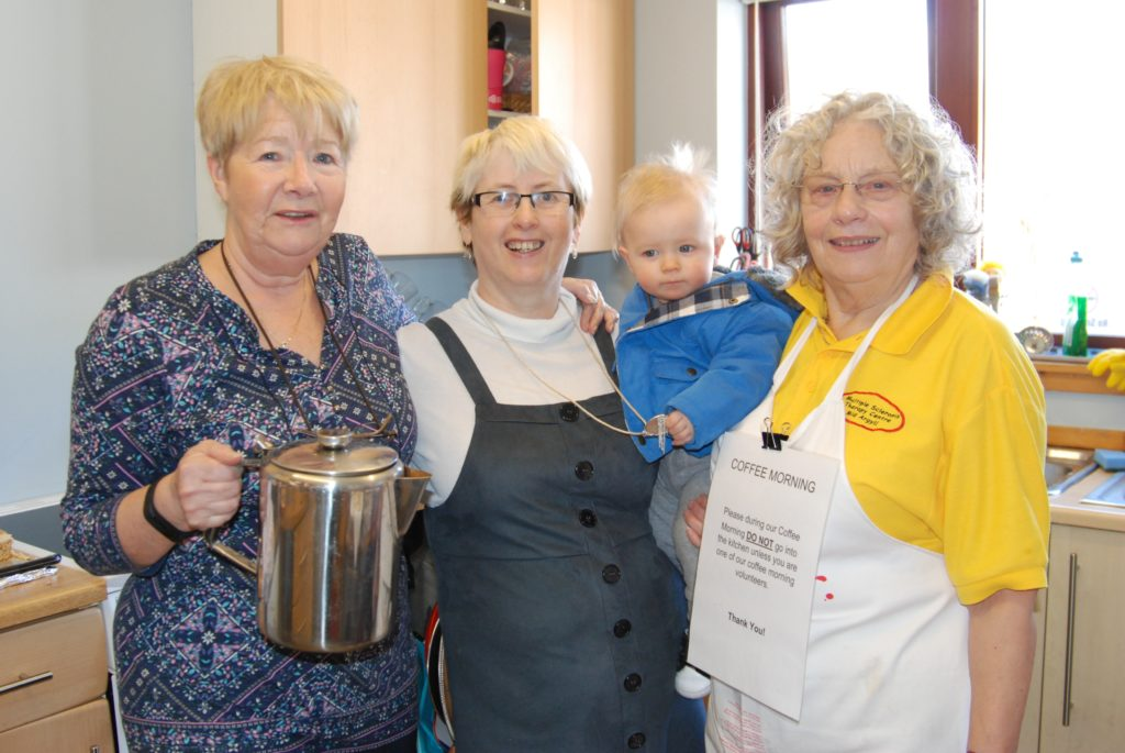 Working hard in the kitchen - from left: Sheila Cameron, Rose Taylor with eight-month-old Jake and Maggie Dodd