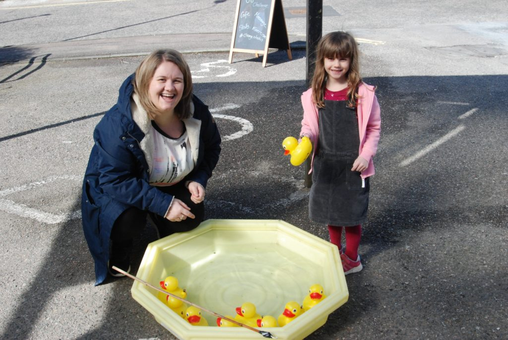 There was duck hooking success for Abbie Stewart, aged six, with a little help from Claire Cameron of the MS Centre