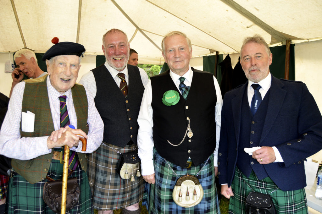 Inside the piping convenor's tent: piping stewards Niall Iain MacLean, Torquil Telfer, Colin Stevenson and Iain Hurst. JS29INVGAMES17