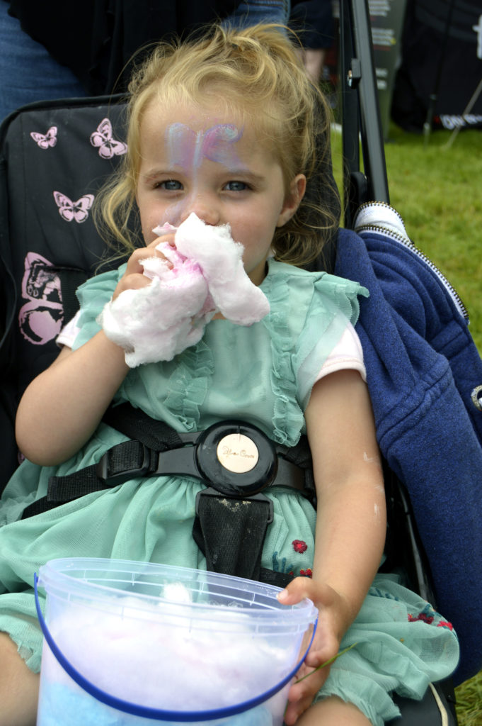 Maryjane Reid tucking into a huge bowl of candyfloss. The two-year-old and her mum Jane were visiting the games with grandparents John and Edith Cook of Lochgilphead. JS29INVGAMES31