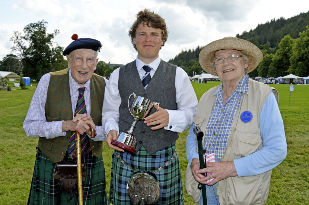 A new trophy was presented to the games this year; the Niall Iain MacLean Cup for over all winner of the grade B piping competition.  An honorary vice-president of the games, Niall Iain and his wife Inez presented the cup to its first winner, John Dew, aged 21, from Crieff, who is a student at the Royal Conservatoire of Scotland. John has also studied with Willie McCallum of Campbeltown.  JS29INVGAMES36