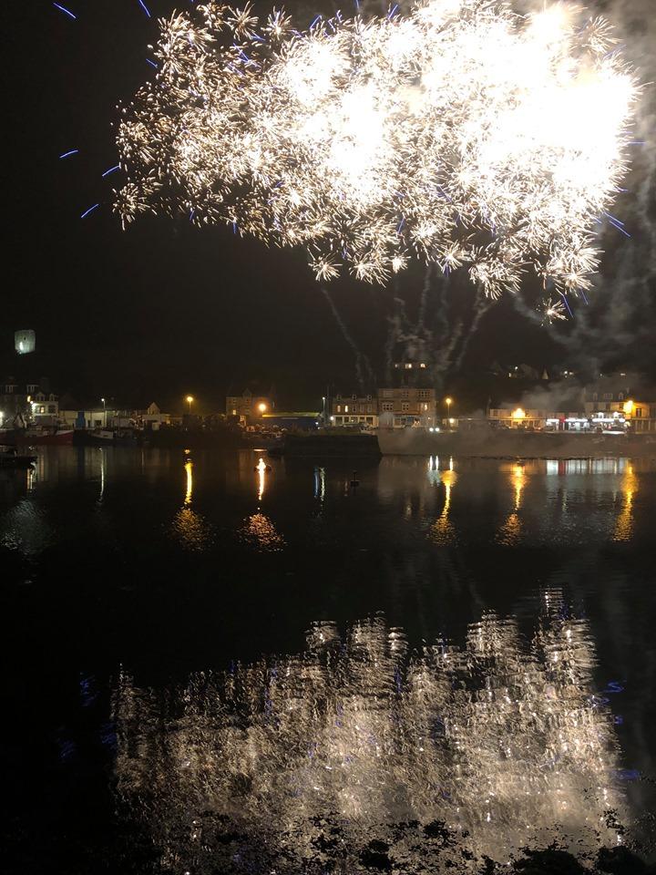 Dazzling displays over Tarbert reflected in the harbour