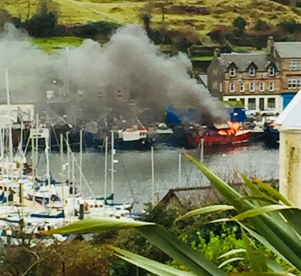 Tarbert fishing boat in quayside blaze