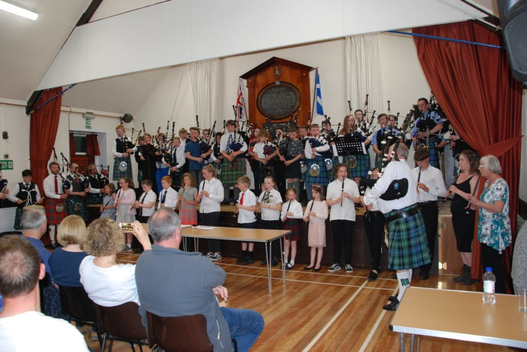 Camron wins trophy as piping school marks 40 years