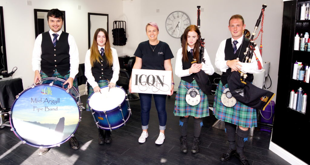 Pipe band travels to worlds in (hair)style