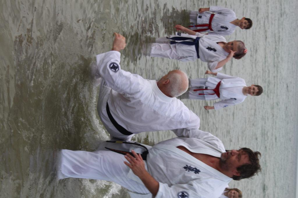 Getting karate kicks at Kilmory beach